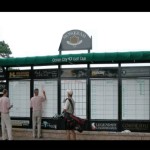 a picture of a golf scoreboard and a set of golfers